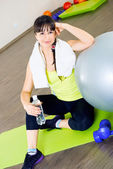 Fitness woman relax with water bottle — Stock Photo