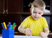 Cute little boy drawing with felt-tip pen — Stock Photo
