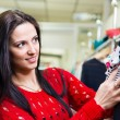 Young pretty brunette shopping - Stock Photo
