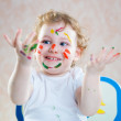 Happy child with painted hands — Stock Photo #23754795