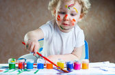 Cute little child painting — Stock Photo
