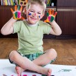 Cute happy boy painting — Stock Photo