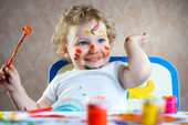Cute little child painting — Стоковое фото