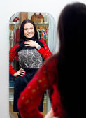 Young girl trying new dress in fitting room — Stock Photo
