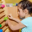 Cute little girl playing with abacus — Stock Photo #25369133