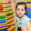 Cute little girl playing with abacus - Stock Photo