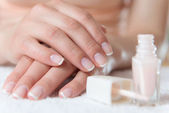 Womans hands with beautiful french manicure — Stockfoto