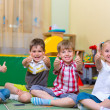 Stock Photo: Excited children holding thumbs up