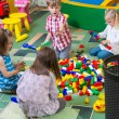Group of kids playing with colorful constructor — Stok fotoğraf