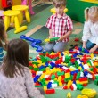 Group of kids playing with colorful constructor — Stock Photo #26021793