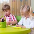 Two cute little prescool kids drawing — Stock Photo #26022051