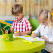 Two cute little prescool kids drawing — Stock Photo