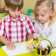 Stock Photo: Two cute little prescool kids drawing