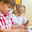 Two cute little prescool kids drawing — Stock Photo #26022279