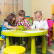 Group of cute little prescool kids playing — Stock Photo