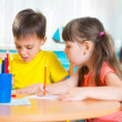 Group of cute little prescool kids drawing — Stock Photo