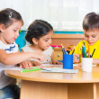 Group of cute little prescool kids drawing — Stock Photo #26459939