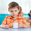Cute little child drinking milk — Stock Photo