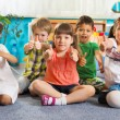 Five little children with thumbs up — Stockfoto