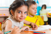 Group of cute little prescool kids drawing — Стоковое фото