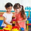 Two little girls playing in daycare — Stock Photo