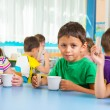 Cute little children drinking milk — Stock Photo