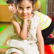 Stock Photo: Portrait of little cute latin girl in daycare