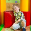 Stock Photo: Cute little boy in daycare gym