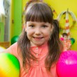 Stock Photo: Cute little girl playing at daycare gym