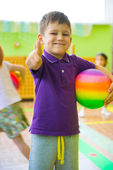 Cute little boy playing at daycare gym — Stock Photo