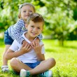 Happy sister and brother together in park — Stock Photo