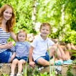 Mother with two children summer outdoors — Stock Photo #27210775
