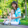Stock Photo: Young mother with her son in park