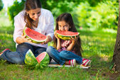 Happy hispanic family eating watermelon — Stock Photo