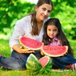 Happy indian family eating watermelon — Stock fotografie