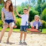 Happy family on playground — Stock Photo