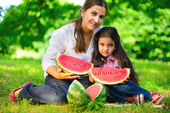 Happy indian family eating watermelon — Stock Photo
