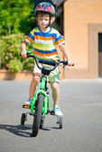 Cute little boy riding bicycle — Stock Photo