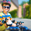Cute little boy with rollers — Stock Photo