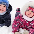 Two cute children playing in winter — Stock Photo