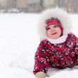 Lovely girl has a fun in snow — Stock Photo