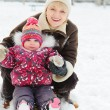 Winter portrait of grandmother and granddaughter — Stock Photo