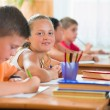 Stock Photo: Schoolchildren in classroom at school