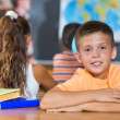 Stock Photo: Smiling boy in classroom at school