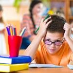 Schoolchildren in classroom at school — Stock Photo