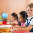 Schoolchildren during lesson in classroom at school — Foto Stock