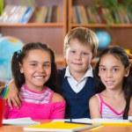Portrait of smart schoolchildren in classroom — Stock Photo #30896211