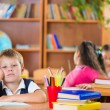 Schoolchildren in classroom at school — Stock Photo