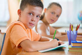 Schoolchildren in classroom at school — Foto Stock