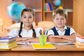 Schoolchildren during lesson in classroom at school — Stock Photo